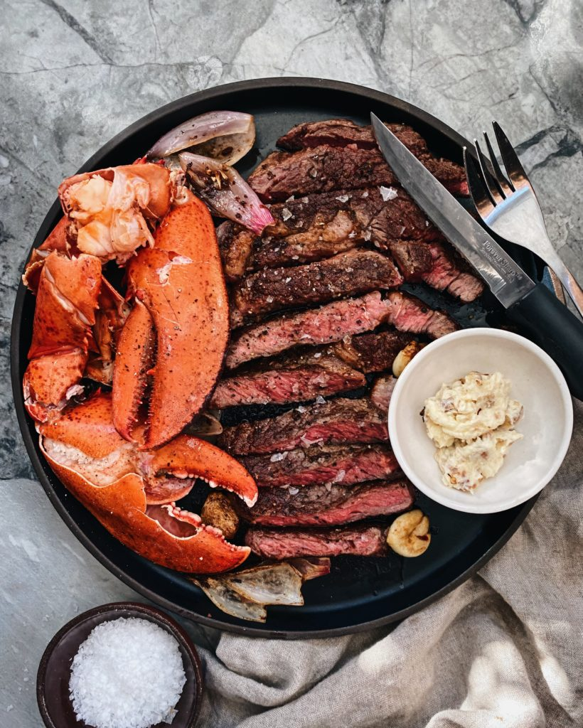 plate of lobster and steak