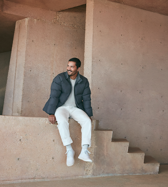 Photo of guy wearing Allbirds puffer and white pants