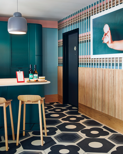Motel kitchen with colourful accents and tiling