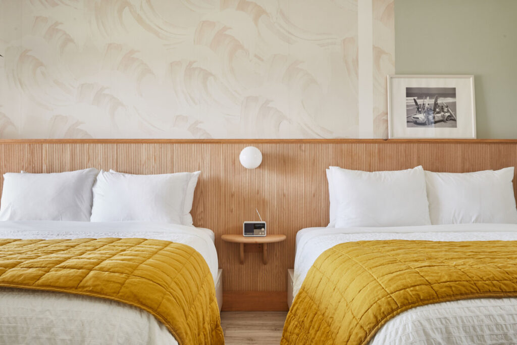 motel room with two beds and yellow blanket