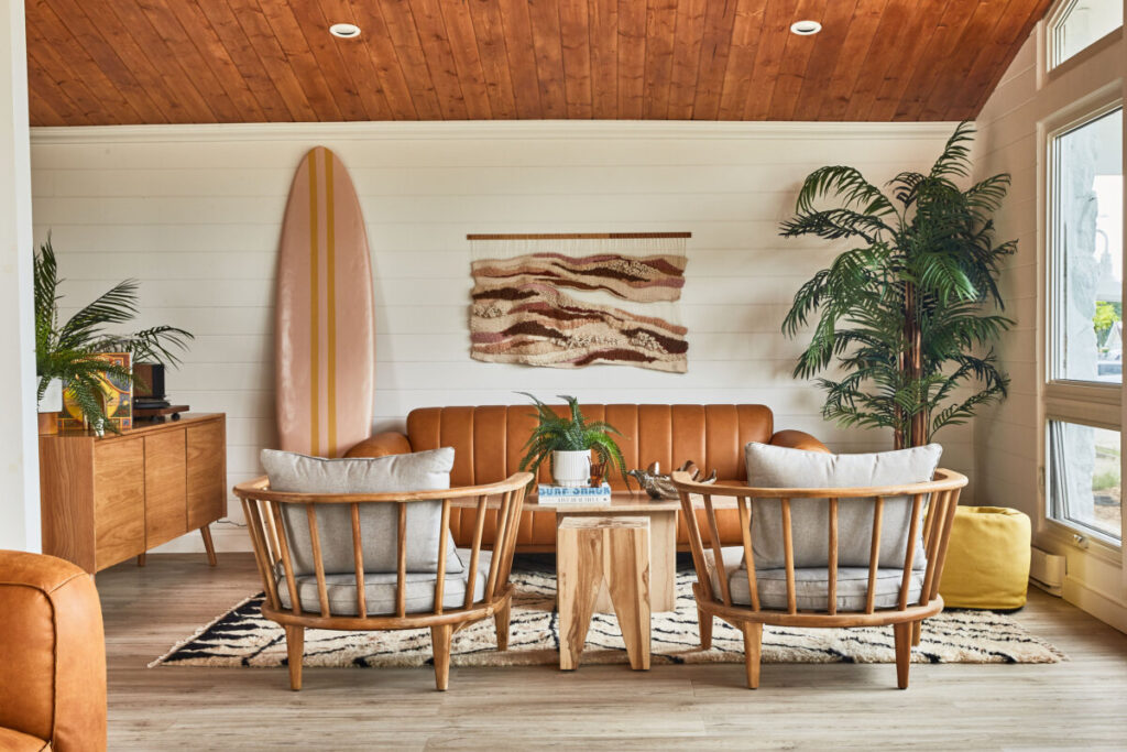 Motel lobby with sofa, surfboard, chairs