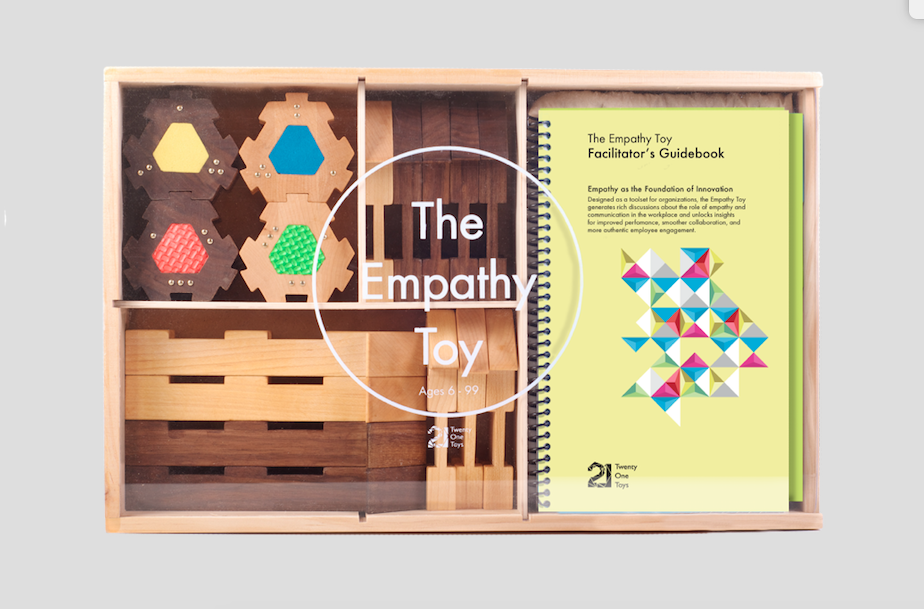 Packaging for Twenty One Toys Empathy Toy with wooden blocks and manual