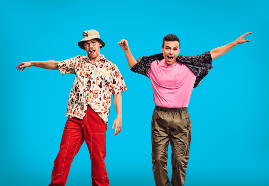AsapSCIENCE duo Greg Brown and Mitchell Moffit jumping up against blue background