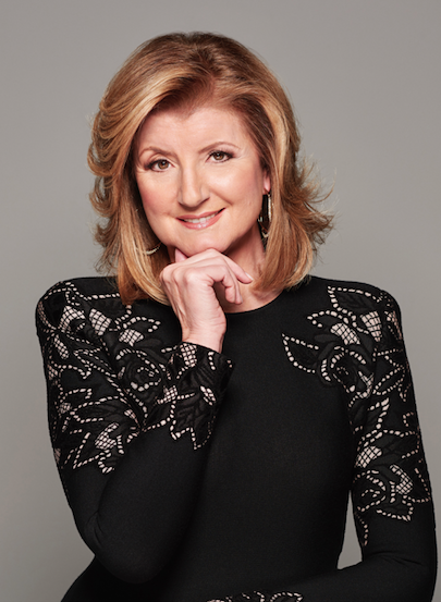 Arianna Huffington wearing lace dress smiling