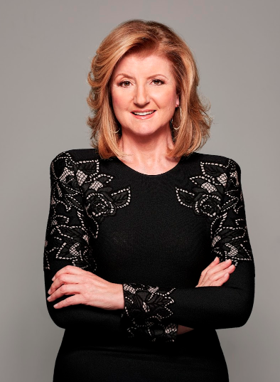 Arianna Huffington in black dress with arms crossed and smiling