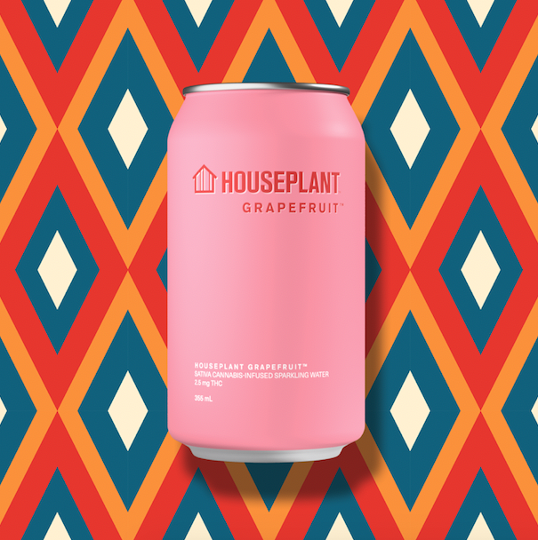 Houseplant beverage in pink can against diamond pattern background