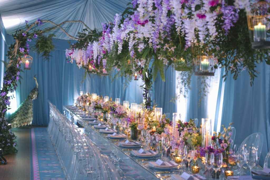 Floral dining table with flowers draped overtop inside tent created by CANDICE&ALISON