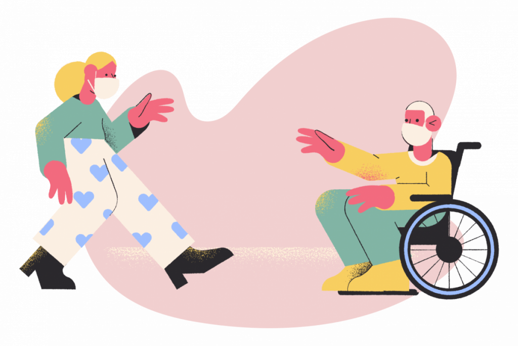 two people wearing masks. One in a wheelchair.