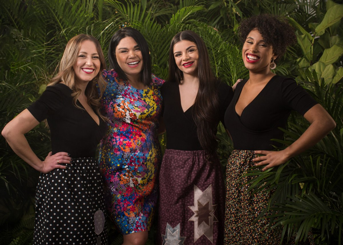 Four women, standing together and smiling. Cheekbone Beauty founder, Jenn Harper, and three models.