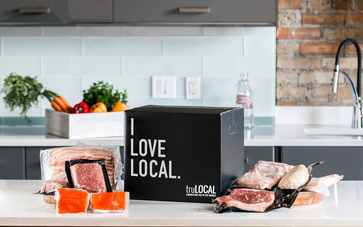 """A black box that says """"I Love Local"""" surrounded by truLOCAL products."""