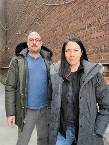 Tomas Ronis and Erin Chan, co-founders of Rhenti, stand outide in winter jackets and smile at the camera
