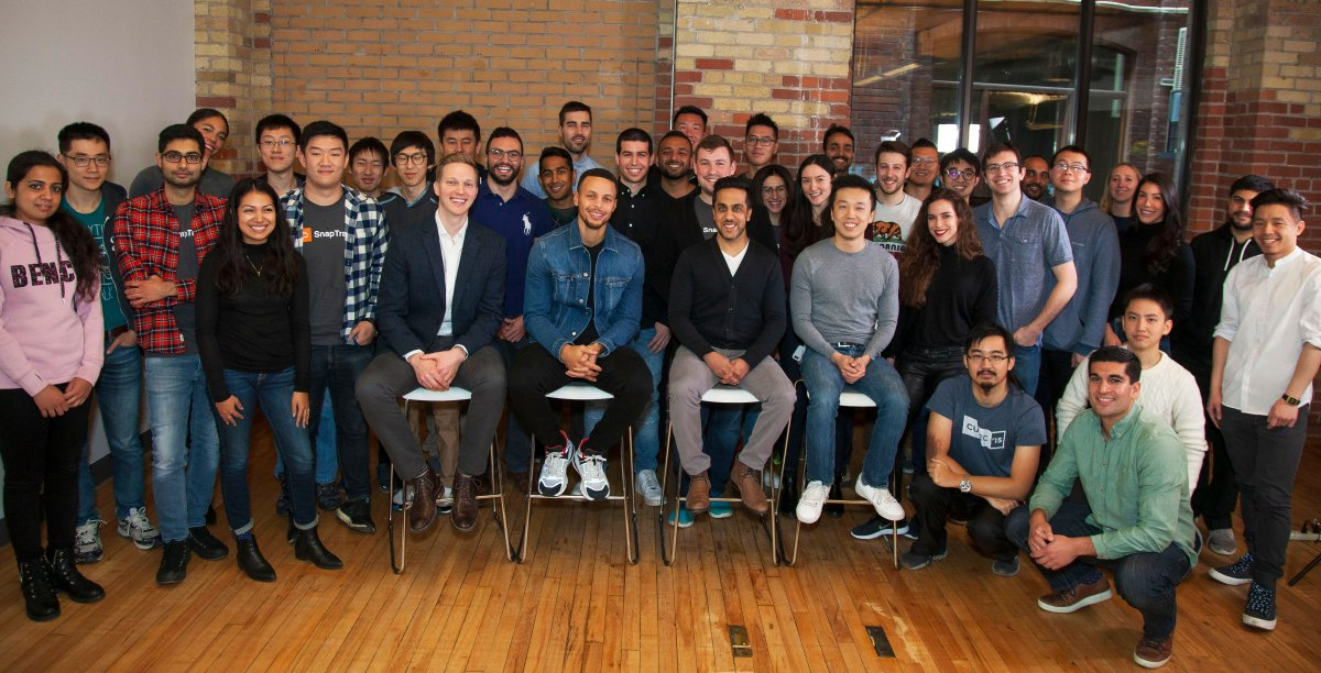 A group picture of the Snapcommerce team with Steph Curry.