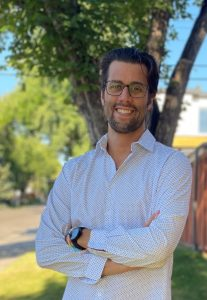 A white man in glasses, Chas Edgelow, CEO and Co-Founder of EverGen, stands with his arms crossed and smiles at the camera.