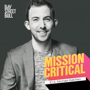 A black and white photo of Michael Katchen, CEO of Wealthsimple, in a blazer and t-shirt. There is Bay Street Bull: Mission Critical branding