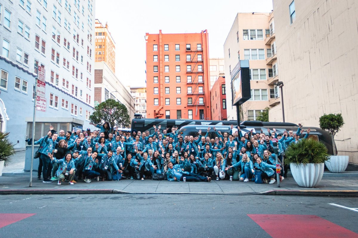 The Traction on Demand team posing across the street.
