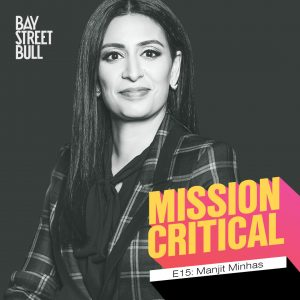 A black and white photo of Manjit Minhas, CEO of Minhas Brewery, Distillery and Winery, wearing a blouse and a plaid blazer. Bay St. Bull and mission critical branding.
