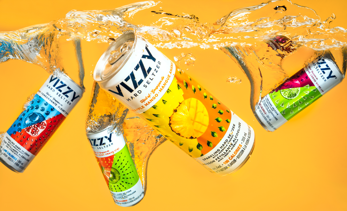 Vizzy Cans spraying water to show how refreshing they are.
